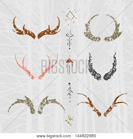 Set of horns in hand-draw style with mystical signs. Colored design elements on texture background.