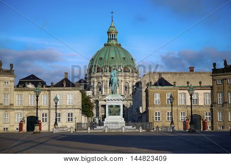 Frederik's Church (Danish: Frederiks Kirke) and Sculpture of Frederik V on Horseback in Amalienborg Square in Copenhagen Denmark poster