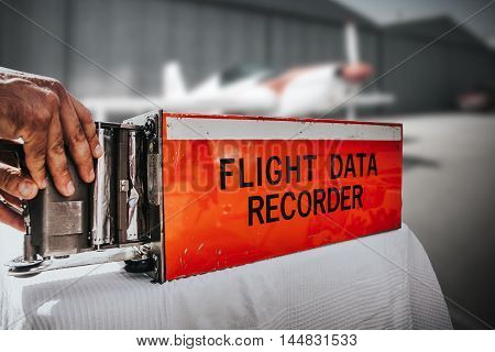 Flight data recorder with hand getting the information.