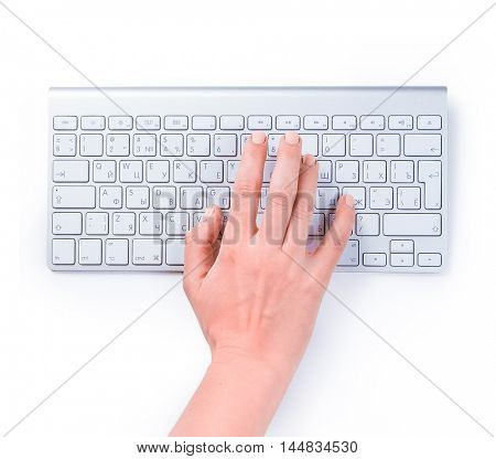 Typing femle hand on keyboard isolated over white