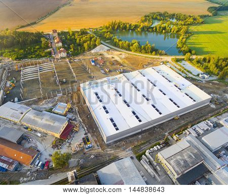 Aerial view of industrial zone with new construction site. Industry, development and investment in European Union.