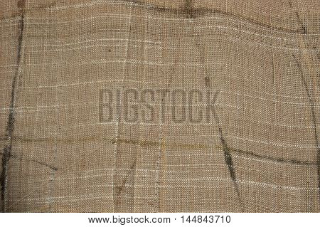 Photo of the Natural linen cloth background. Organic fabric texture patterns.