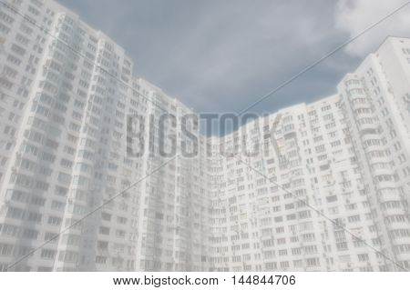 multi-storey buildings blurred background with a light tone