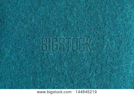 Photo of the Close up cyan woollen knitted fabric texture. Angora background
