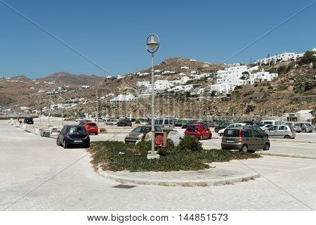Mykonos, Greece - August 14 2016: Mykonos main parking lot at the port. Due to the tight Mykonos Town paths, cars are not allowed in the town. A free parking area exists in the old port area.