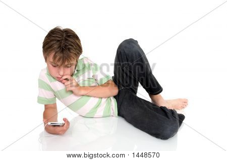 Child Relaxing With An Electronic Gadget
