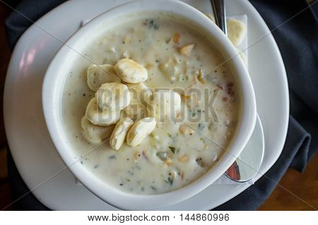 Creamy New England Clam Chowder garnished with oyster crackers