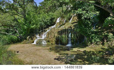 A small waterfall near Roski Slap waterfall on the River Krka in Krka National Park Sibenik-Knin County Croatia.