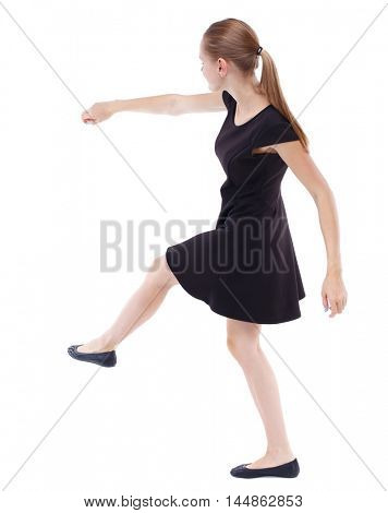 skinny woman funny fights waving his arms and legs. Blonde in a short black dress kicking ball