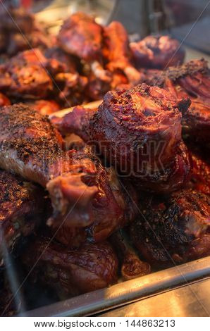 Crispy and juicy barbecue turkey legs on catering platter
