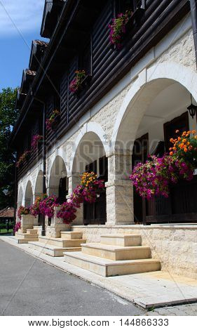 beautiful wooden and stone facade decorated with flowers  - railway station in Mokra Gora, Serbia