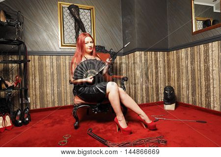 Red hair Dominatrix play with slave domination role