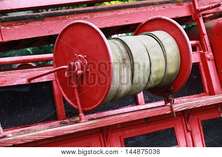 Old Red Fire Hose Reel, Closeup Photo