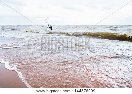 View of storm seascape. Windsurf board. Water sport