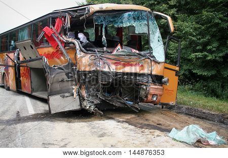 KOVEL UKRAINE - JULY 11: Scene of bus crash where nine Ukrainian Belarusian and Bulgarian Tourists were died and as many as 30 others were injured July 11 2013 just outside Kovel Ukraine.