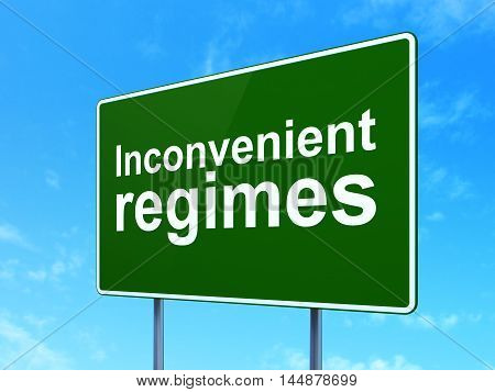 Political concept: Inconvenient Regimes on green road highway sign, clear blue sky background, 3D rendering