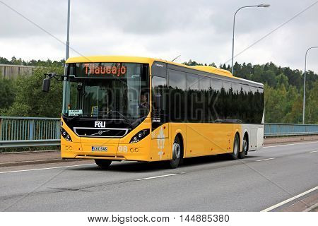 PARAINEN, FINLAND - AUGUST 26, 2016: Yellow Volvo 8900 city bus moves along brigde in Parainen in urban environment on a cloudy day.