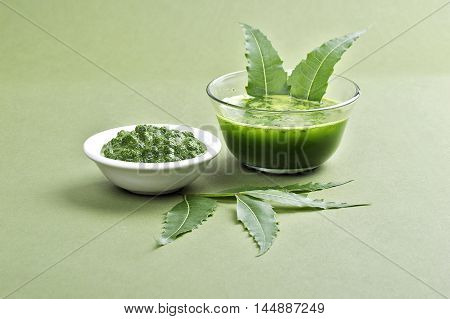 Medicinal Neem leaves paste and juice with leaves on green background