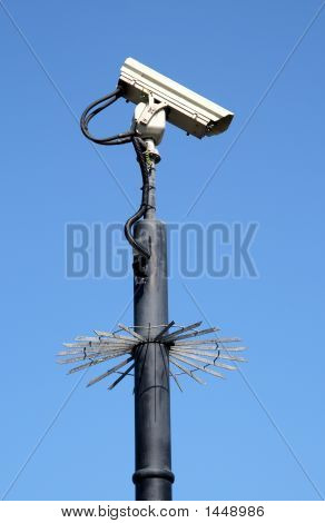 Street Security Cctv Camera And A Blue Sky.