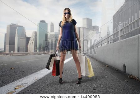 Beautiful woman holding some shopping bags on a city street