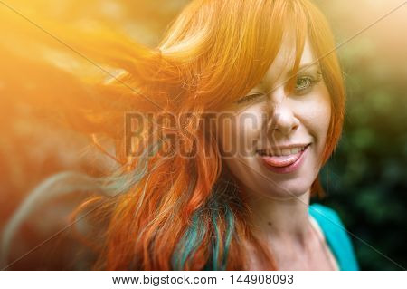 Young Trendy Woman With Colored Bright Red Head