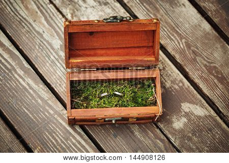 Wedding Rings In Wooden Vintage Box On Moss