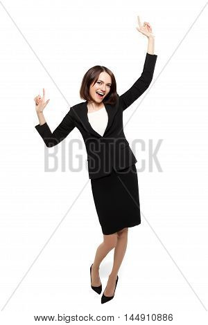 Successful young business woman happy for her success. Isolated on white background. Mixed Asian Caucasian businesswoman.