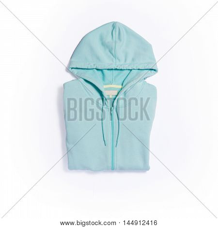 Mint color hoodie top view on white background