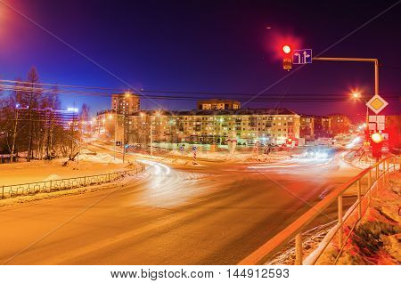 NIZHNY TAGIL RUSSIA - FEBRUARY 13 2016: The red light is lit on the traffic light at the intersection of roads in the winter in the dark