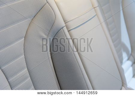 Car seat from light skin. Close-up view. Small depth of field.Stock photo