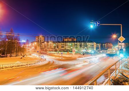 NIZHNY TAGIL RUSSIA - FEBRUARY 13 2016: The green light is lit on the traffic light at the intersection of roads in the winter in the dark