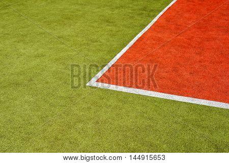 tennis artificial green and red grass court