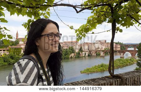 girl in front of a view of Tarn river and Albi in France