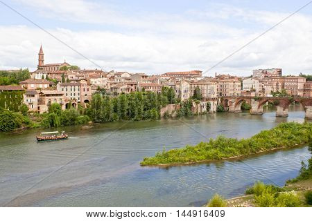boat in Tarn river with a view of Albi France