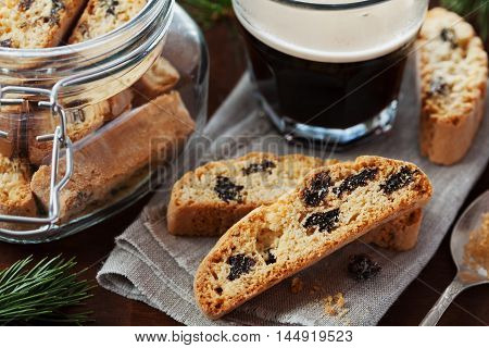 Coffee with biscotti or cantucci on wooden vintage table. Traditional Italian biscuit or cookie.