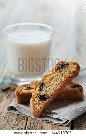 Biscotti or cantucci with raisins on wooden rustic table. Traditional Italian biscuit or cookie.