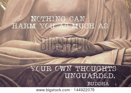 Nothing can harm you as much - famous Buddha quote printed on image of sculpture's hands in peaceful position original photo id 20531768 is used