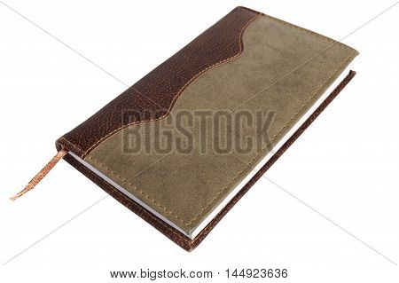 close up of notebook with leather binding isolated over white