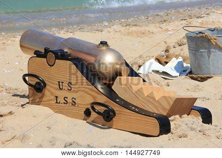A Lyle Gun sits on a beach in Sleeping Bear Dunes National Lakeshore, MI