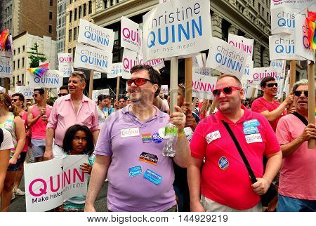 New York City - June 29 2013: Supporters of NYC Council Speaker Christine Quinn holding signs for her mayoral candidacy at the Gay Pride Parade on Fifth Avenue