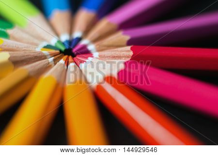 Color pencils in arrange in color wheel. Assortment of colored pencils.