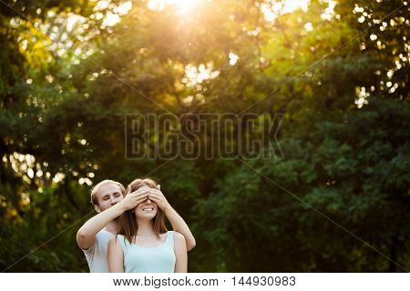Young beautiful couple resting, walking in park, smiling, rejoicing