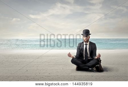 Businessman relaxing at the seaside
