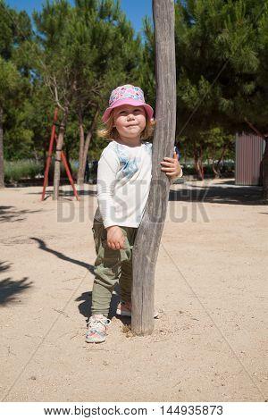 Little Kid Standing At Urban Park