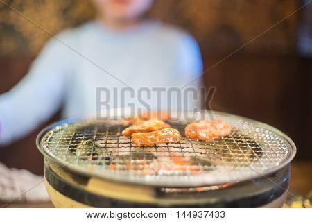 Japanese girl is having Yakiniku Coal Grill