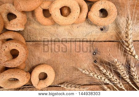 Taralli on the wood tableTraditional Italian snack from Puglia.