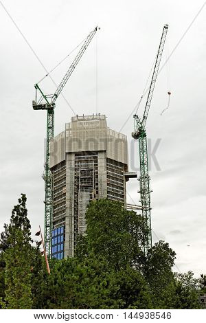 LONDON ENGLAND - JULY 8 2016: 360 London also known as London Park Hotel under construction. New 44-storey tower located near Strata at Elephant and Castle on the former site of the London Park Hotel.