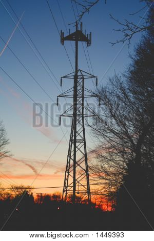 Power Line With Cell Tower At Sunset