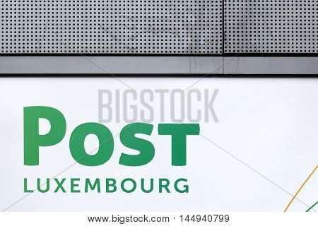 Luxembourg city, Luxembourg - August 12, 2016: Post Luxembourg sign ona wall. Post Luxembourg is a mail and telecommunications company based in Luxembourg