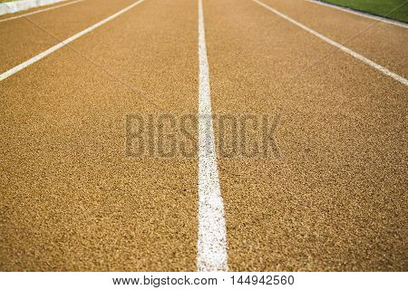 Close up of the beige lane on a running track
